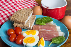 boiled eggs with ham and bread breakfast on table Royalty Free Stock Images