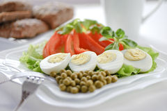 Boiled eggs on the leaves of lettuce Stock Photos