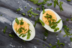Boiled eggs on marble table Royalty Free Stock Photos