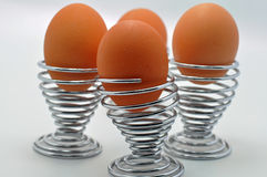 Boiled eggs in metal egg cups Royalty Free Stock Image