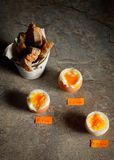 Boiled eggs by the minute. On stone table royalty free stock images