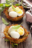 Boiled eggs in nests. Stock Photo