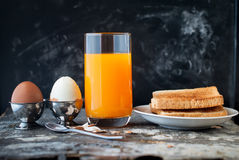 Boiled Eggs Orange Juice Toasts Spoon Rustic. Black Background Stock Photo