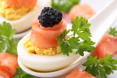 Boiled eggs with red black caviar Stock Photography