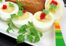 Boiled eggs with red caviar. Stock Photography