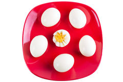 Boiled eggs on red plate Stock Photo