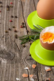 Boiled eggs and rosemary Stock Photo