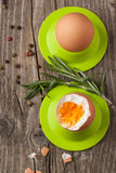 Boiled eggs and rosemary Royalty Free Stock Photography