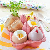 Boiled eggs with salt and pepper shakers Royalty Free Stock Photography