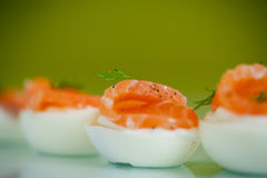 Boiled eggs with salt red fish Stock Photos