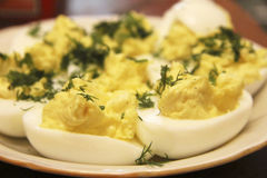 Boiled eggs sliced in halves stuffed and filling by pasta with d Royalty Free Stock Images