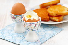 Boiled eggs and toasts for breakfast Royalty Free Stock Images