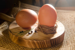 Boiled eggs. Tow boiled eggs on a wood table Stock Photos
