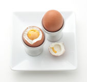 Boiled eggs on white plate Stock Photos
