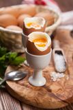 Boiled eggs on a wooden background Royalty Free Stock Images