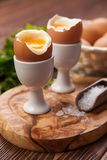 Boiled eggs on a wooden background Stock Photos
