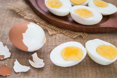 Boiled eggs and wooden plate Stock Image