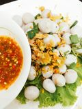 Boiled fish ball with vegetables, fried garlic and spicy sauce. Food snack Stock Photography