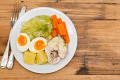 Boiled fish with boiled vegetables on white plate Royalty Free Stock Photos