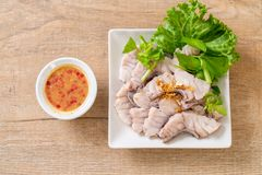 Boiled fish dip with sauce. And vegetable royalty free stock images