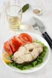 Boiled fish with glass of wine Royalty Free Stock Photos