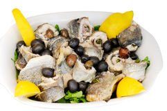Boiled fish with olives and lemon Royalty Free Stock Images