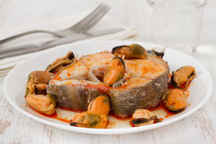 Boiled fish with sauce and mussels Royalty Free Stock Photography