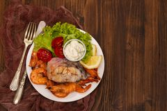 Boiled fish with shrimps and salad on white dish Stock Photography