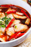 Boiled fish. Sichuan poached sliced fish in hot chili oil royalty free stock photos