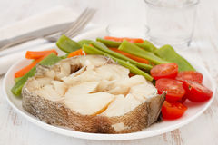Boiled fish with vegetables Stock Image