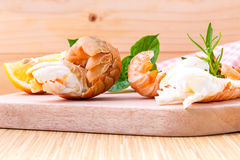 Boiled Flathead lobster, Lobster Moreton Bay bug, Oriental flath. Ead lobster with herbs and spices  sauce on wooden background Stock Photography