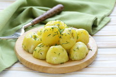 Boiled fresh organic potatoes with the oil Royalty Free Stock Photo