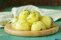 Boiled fresh organic potatoes with the oil Royalty Free Stock Photos