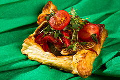 Boiled and fried chicken on golden puff pastry Stock Image