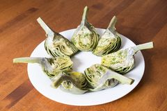 Boiled Globe Artichokes Quartered and Marinated with Olive Oil, Lemon Juice and Fresh Mint #1 Royalty Free Stock Photography