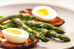 Boiled green asparagus with bacon Royalty Free Stock Photo