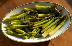 Boiled green asparagus in dish Royalty Free Stock Photo