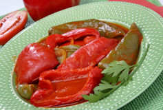 Boiled green and red peppers. In tomato sauce Royalty Free Stock Image