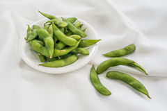 Boiled green soy beans Stock Images