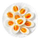 Boiled halved eggs on a  plate  isolated on white background Stock Photo