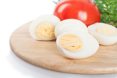 Boiled hen eggs and tomato Stock Images