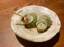 Boiled Japanese mollusk on a plate Royalty Free Stock Photos
