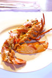 Boiled lobster with cranberry puree Stock Photos