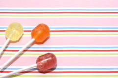 Boiled lollies on striped background (2). Boiled lollies on striped background in candy colours Stock Photos