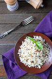 Boiled long grain rice on a ceramic plate Royalty Free Stock Images
