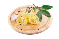 Boiled lumaconi pasta on wood platter. Royalty Free Stock Photography