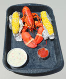 Boiled Maine lobster with corn and coleslaw salad Stock Photo
