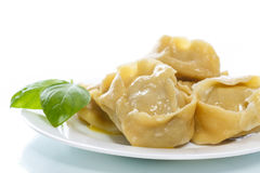 Boiled manti with meat on a plate. Isolated on white Stock Image