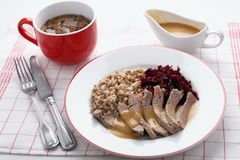Boiled meat with buckwheat porridge. Boiled beef meat with buckwheat porridge, beetroot salad, and beef broth Royalty Free Stock Images