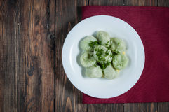 Boiled meat dumplings served with sour cream and dill. Traditional Russian pelmeni. Top view Royalty Free Stock Image